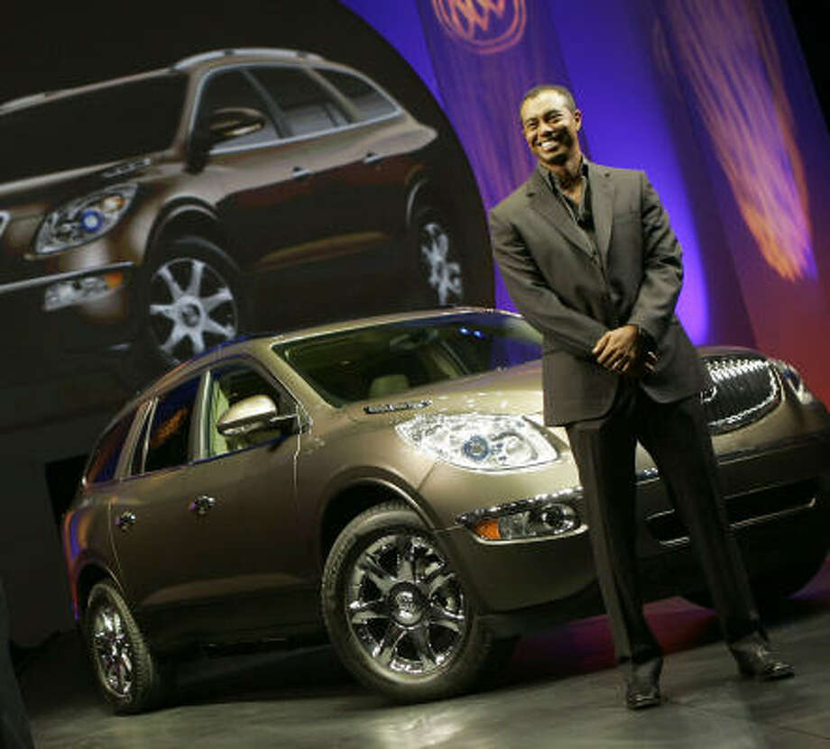 Tiger Woods helped to introduce the 2008 Buick Enclave to the media at the Los Angeles Auto Show in Pasadena, Calif., in 2006. General Motors Corp. said it will end its endorsement deal with the golfter at year's end. Photo: CHRIS CARLSON, AP