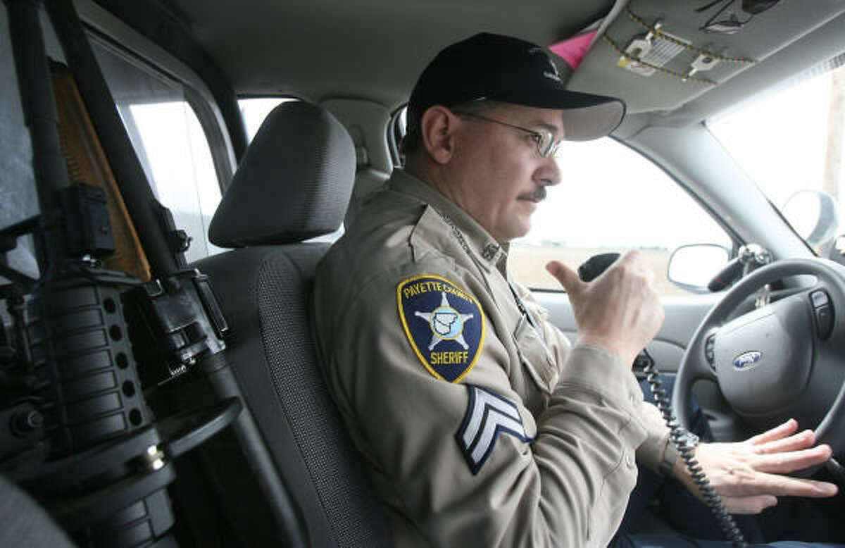 Cpl. Brian Bullington of the Payette County Sheriff's Office in Payette, Idaho, patrols around the county on Wednesday, March 12, 2008. Between the front seats, Bullington rides with an AR-15 rifle. Although he doesn't find much reason to use it in Payette County, Bullington says that during training exercises the AR-15 has been light weight and easy to use.