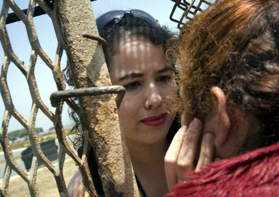 Francelia Menchaca drove with her family from Phoenix to the Tijuana border to see her mother at the fence on Saturday. Photo: SARAH I. VOISIN, WASHINGTON POST
