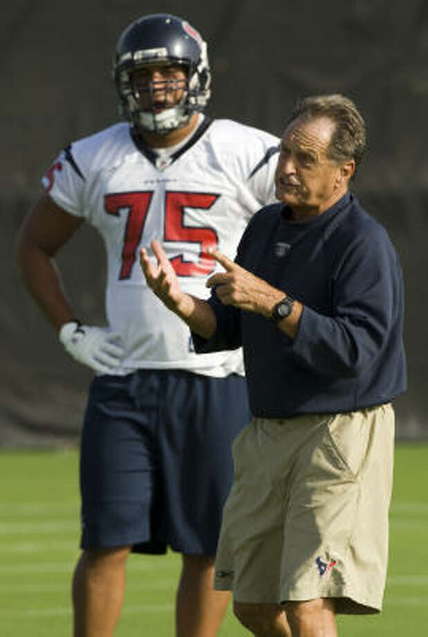 Texans assistant head coach Alex Gibbs gives instruction, with tackle Brandon Frye (75) in the background, during the opening practice of Texans training camp last Friday. Photo: Brett Coomer, Houston Chronicle