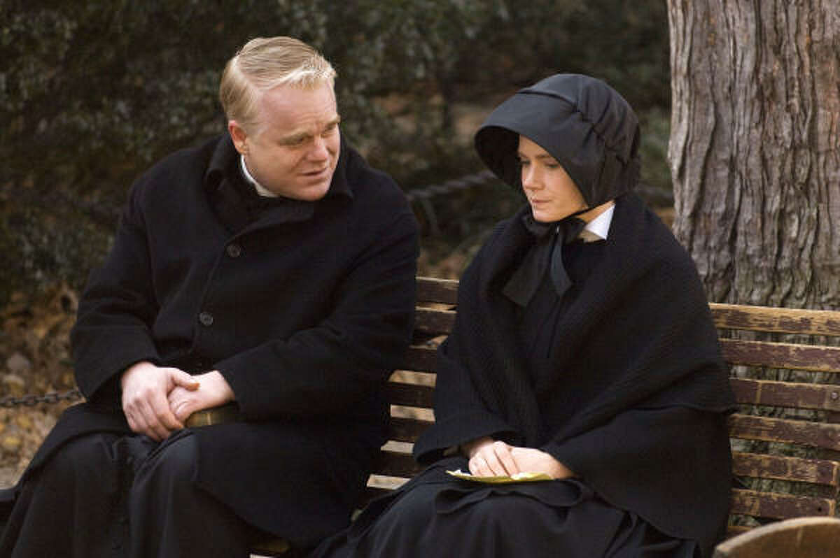 The Rev. Flynn (Philip Seymour Hoffman) talks with Sister James (Amy Adams) about Flynn's possible inappropriate relationship with a student.