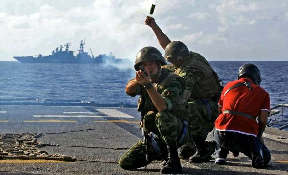 Members of the Venezuelan Navy participate in naval maneuvers with Russian ships in the Caribbean Sea on Dec. 2. President Hugo Chavez has been making changes to the professional army. Photo: MAIQUEL TORCATT, AFP/GETTY IMAGES
