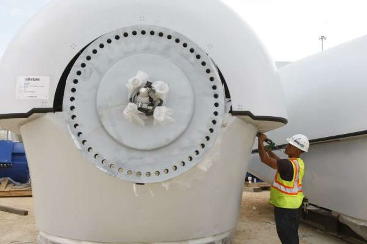 Vincent Hess of Clute prepares a generator for a wind turbine to be shipped from the port.