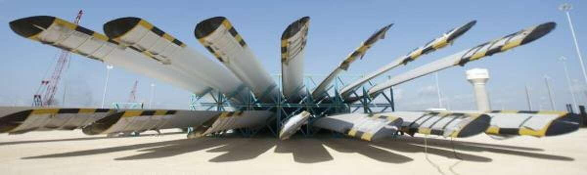 A collection of 144-foot-long blades waits for restoration or pickup at the Port of Freeport. Freeport began bringing in ships loaded with turbines two years ago and expects that business to double next year.