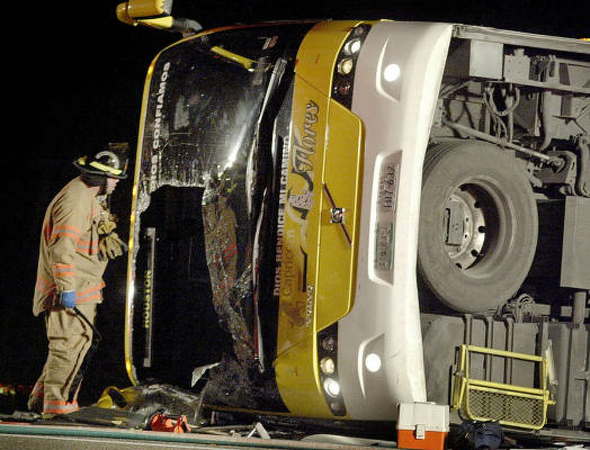A firefighter responds on the scene on U.S. 59 south of Victoria early Wednesday morning.