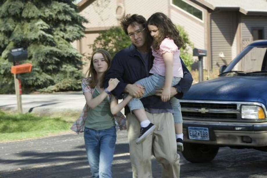 Shelan O'Keefe, left, John Cusack, center, and Grace Bednarczyk star in Grace Is Gone. Photo: The Weinstein Company