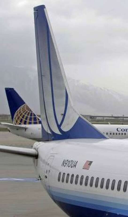 A Continental jet pulls away from the gate near a United jet in Salt Lake City on Tuesday. Photo: GEORGE FREY, GETTY IMAGES