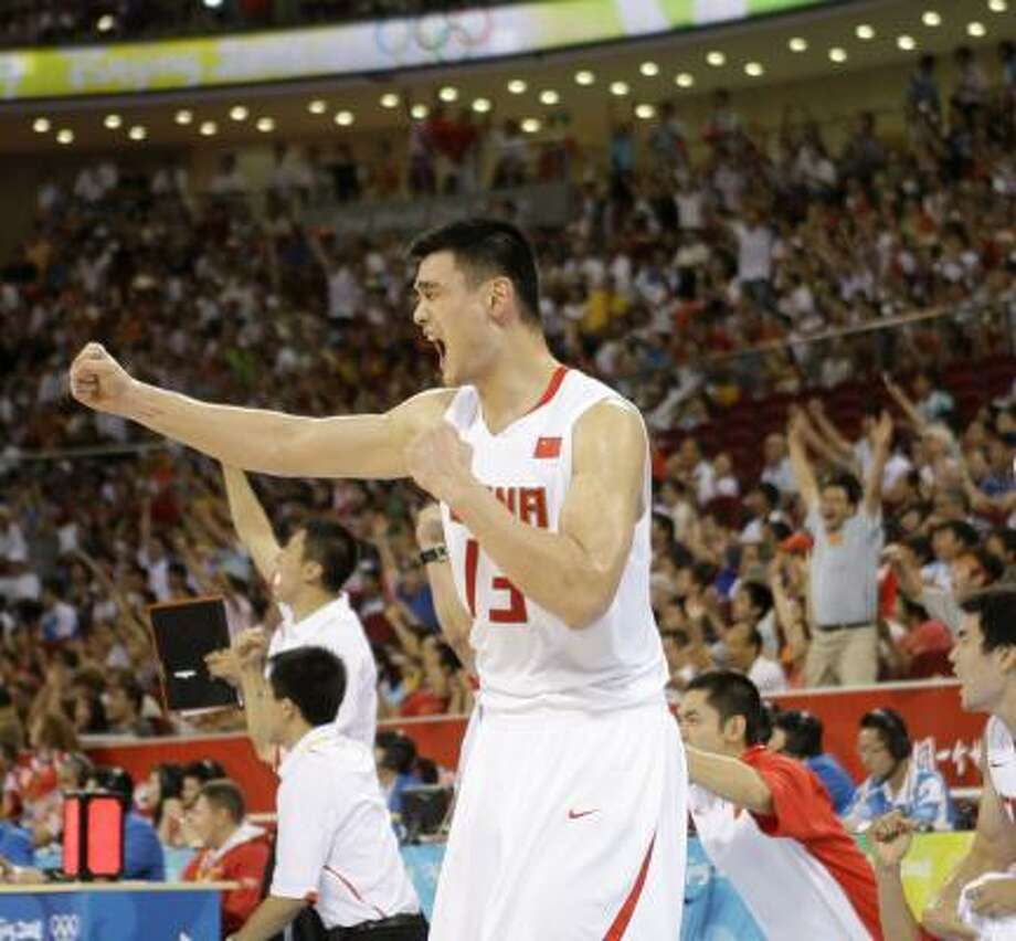 Yao Ming in a happy moment. He said the Chinese team has no time to dwell on Tuesday's loss. Photo: Eric Gay, AP