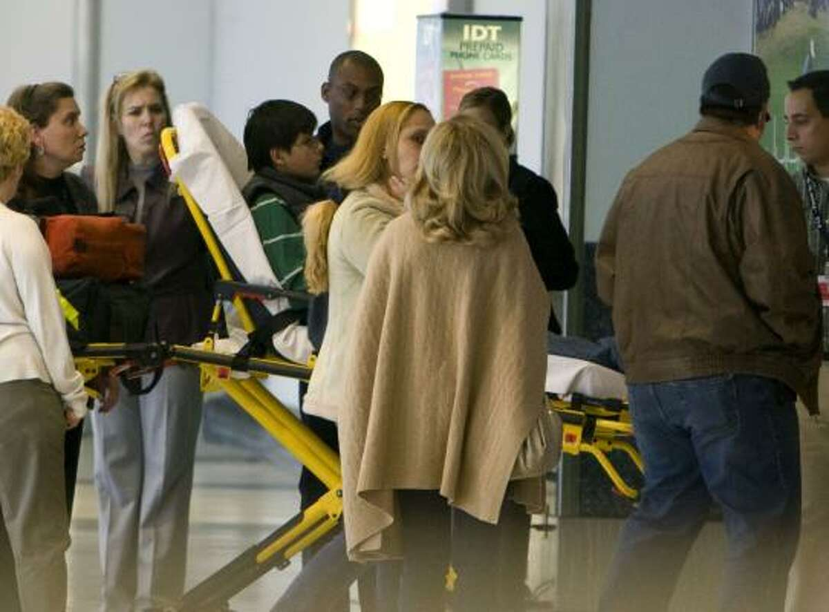 A boy is taken by stretcher straight into an elevator after arriving Sunday from Denver at Bush Intercontinental Airport.