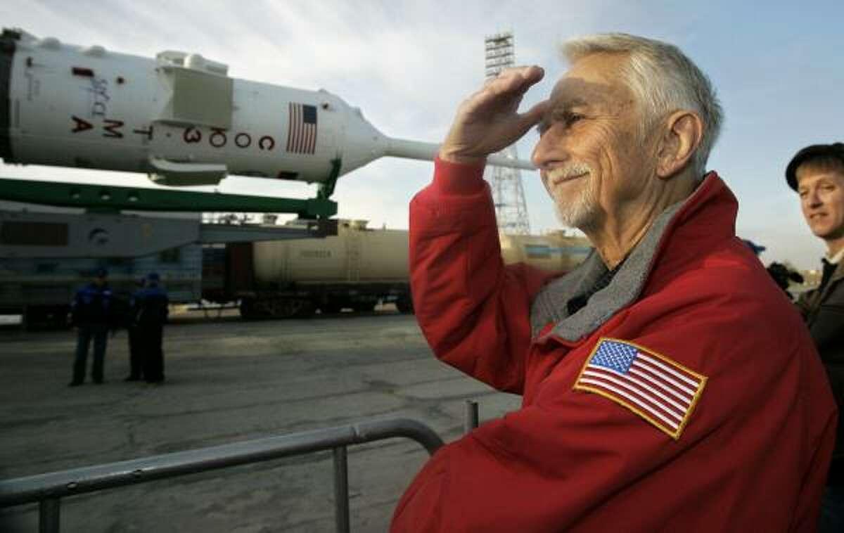 Owen Garriott studies the Soyuz spacecraft that will carry his son, Richard Garriott, to the international space station. The elder Garriott, a former astronaut, spent nearly two months aboard the American Skylab space station in 1973.