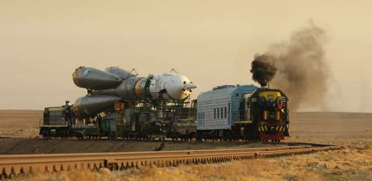 The Russian Soyuz spacecraft is moved to the launch pad of the Russian-leased Baikonur Cosmodrome Friday in Kazakhstan ahead of its planned liftoff this weekend.