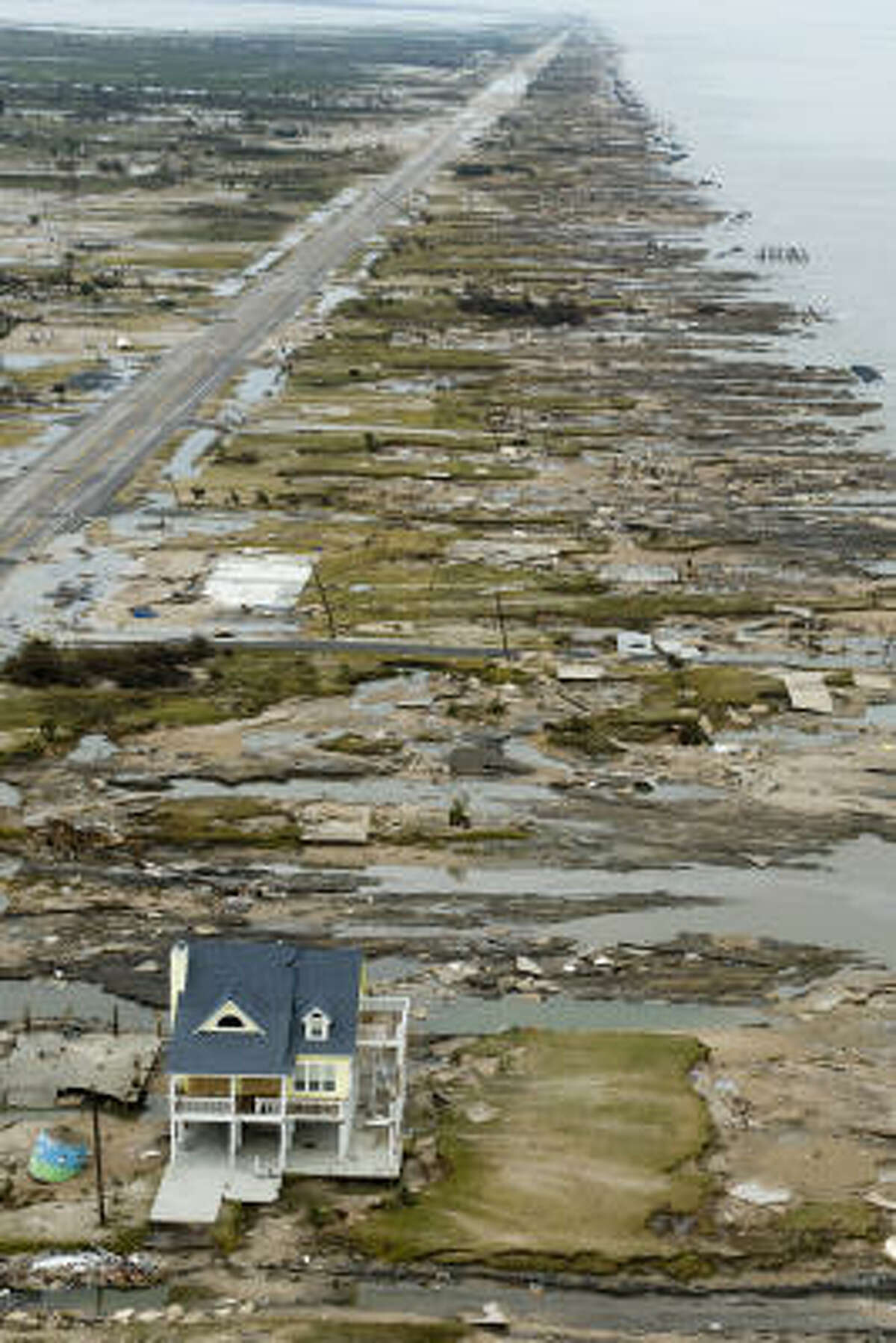 A single house is left standing amidst the devastation left by Hurricane Ike in Gilchrist, Texas.