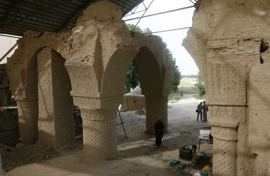 Afghan workers gather at the site in the Balkh province in Afghanistan to restore the ornate 9th century mosque of Noh-Gonbad or Nine Cupolas, the oldest and one of the finest examples in the world from that period. French archaeologists believe they have found a long-forgotten city there. Photo: RAFIQ MAQBOOL, ASSOCIATED PRESS