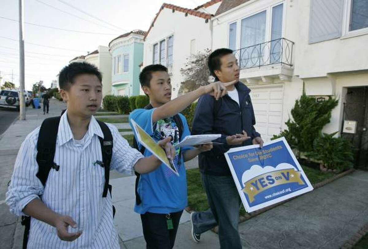 Steven Zheng (from left), Anthony Truong and Roger Vien campaign to keep the Junior Reserve Officers' Training program alive. Critics say JROTC is an arm of the military that discriminates against gays.