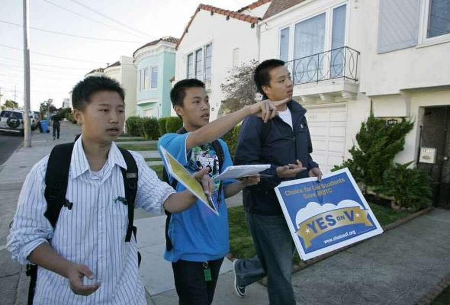 Steven Zheng (from left), Anthony Truong and Roger Vien campaign to keep the Junior Reserve Officers' Training program alive. Critics say JROTC is an arm of the military that discriminates against gays. Photo: ERIC RISBERG, ASSOCIATED PRESS