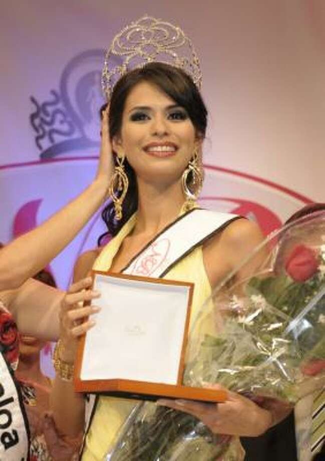 "Laura Zuniga, crowned Miss Sinaloa 2008, told police she and the men were going to Colombia and Bolivia on ""a shopping trip."" Photo: Associated Press"