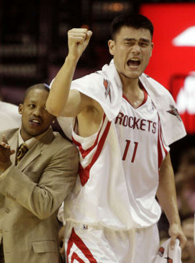 Yao Ming and Steve Francis cheer a successful Rockets' fast break. Photo: Dave Einsel, AP
