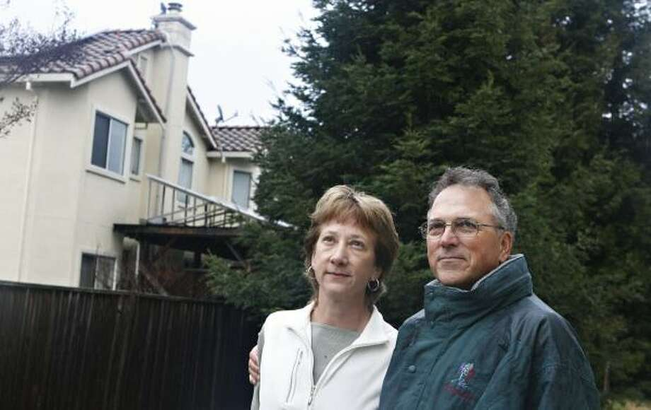 Carolynn Bissett and husband Richard Treanor have appealed a decision ordering them to cut down two of eight shade-casting redwoods in their backyard in Sunnyvale, Calif. Photo: JOANNE HO-YOUNG LEE, SAN JOSE MERCURY NEWS