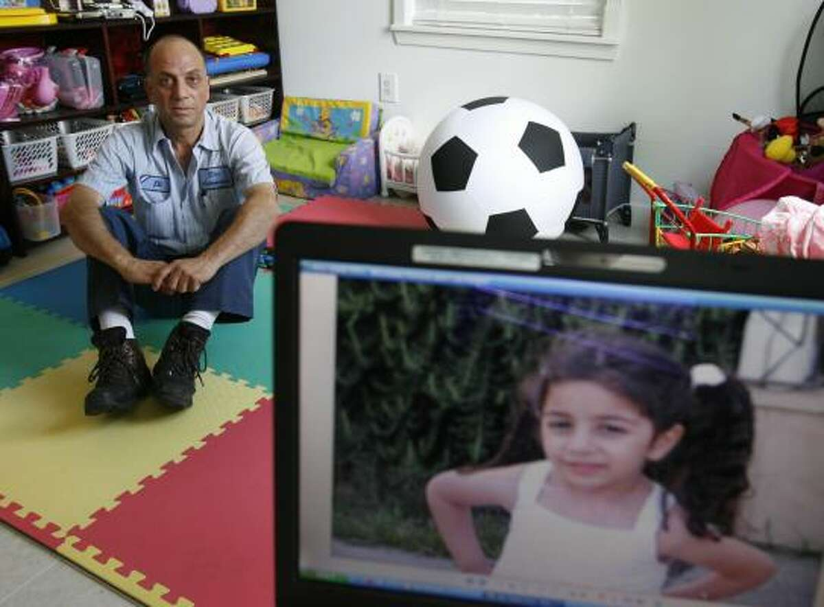 Elias Mama, of Houston, has been separated from his daughter, Dorin, 4, and his wife for about a year because of the federal backlog for visa and naturalization applicants. His family is in Israel.