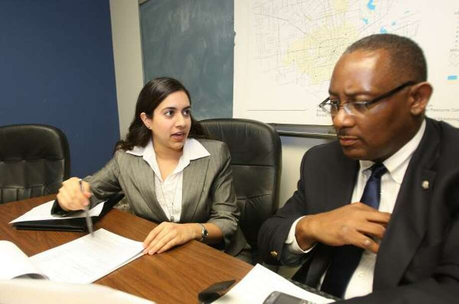 Sagari Betté, a 2008 Stanford University graduate, discusses a project in the City of Houston Health and Human Services Department with senior staff analyst Ernest Davis. Photo: MARGARET BOWLES, FOR THE CHRONICLE
