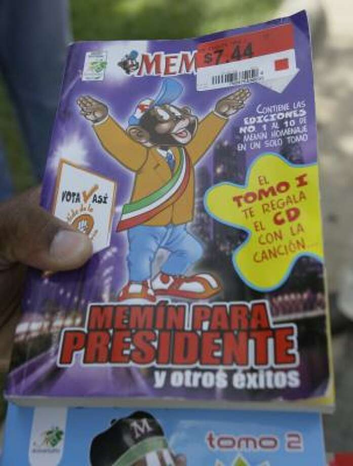 Quanell X holds two Memín comic books purchased from Wal-Mart on South Post Oak. The main character, deemed racist by some in the U.S., is popular in Mexico. Photo: MELISSA PHILLIP, CHRONICLE