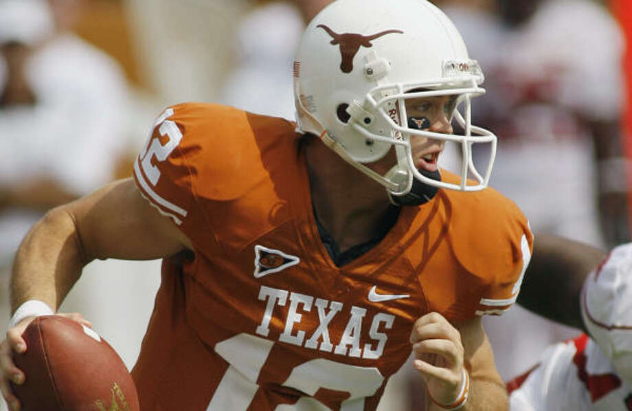 Texas QB Colt McCoy has completed 30 of 44 passes for 432 yards and four touchdowns against the Sooners. Photo: Harry Cabluck, AP