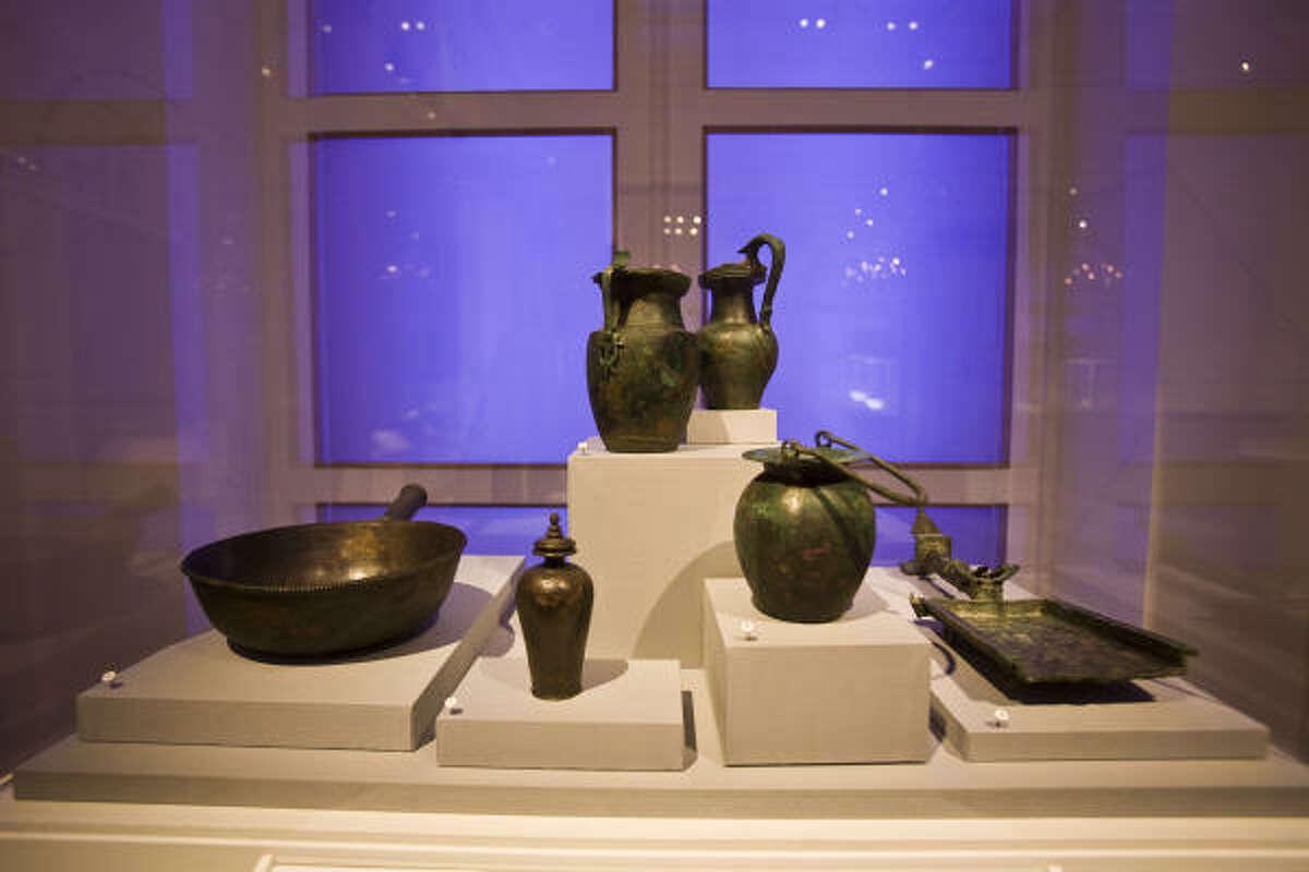 Metal vessels are on display.