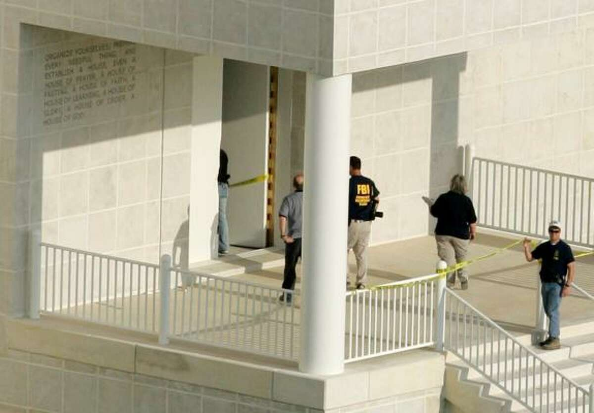 An FBI agent and another law enforcement official walk into the temple at the Yearning for Zion Ranch, home of the Fundamentalist Church of Jesus Christ of Latter Day Saints, on Tuesday in Eldorado.