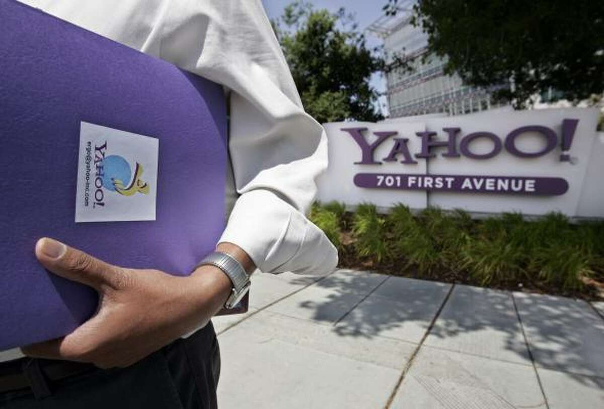 A worker leaves Yahoo headquarters in Sunnyvale, Calif. CEO Jerry Yang is in a fight for the company with investor Carl Icahn.