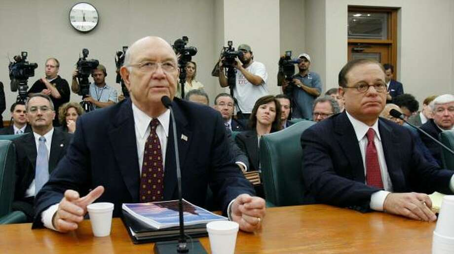 Texas Department of Public Safety Director Thomas Davis, left, who announced his retirement Friday, testifies to members of the Sunset Advisory Commission in June as Chairman Allan Polunsky looks on. The DPS has fallen under harsh criticism in the last two months. Photo: HARRY CABLUCK, ASSOCIATED PRESS