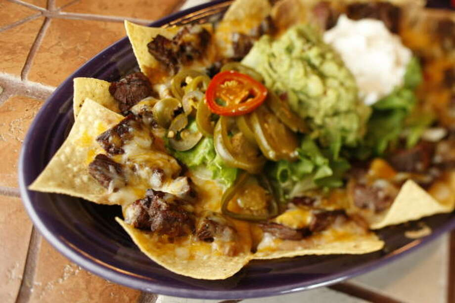 The beef fajita nachos at My Amigos are among the best in Houston, mesquite smoky and served with two kinds of cheese. Photo: Kevin Fujii, Houston Chronicle