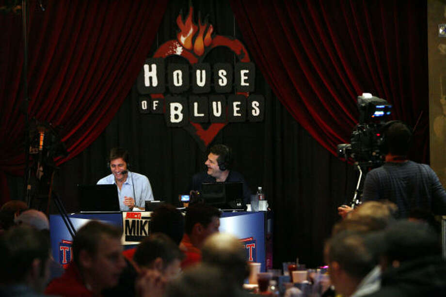 National radio personalities Mike Greenberg, left, and Mike Golic host their show from the House of Blues on Monday morning. Photo: Eric Kayne, Chronicle