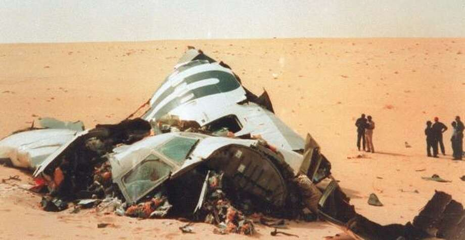 Investigators look over debris of the UTA airliner blown up in September 1989 over the Sahara desert in Niger, killing 170 people. Photo: SIRPA, GETTY IMAGES FILES