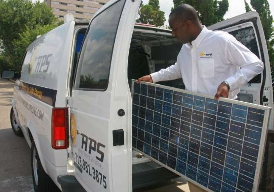 Ralph Parrott, president of Alternative Power Solutions, loads a solar electric panel into his van. Photo: GARY FOUNTAIN, FOR THE CHRONICLE