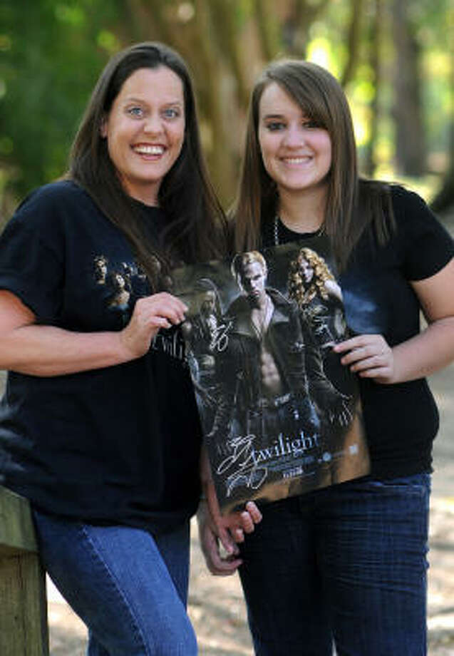 Sheri St. Clair, left, and her daughter, Brittani Winter, 14, a freshman at Huntsville High School, show off one of their Twilight posters. Photo: Jerry Baker, For The Chronicle