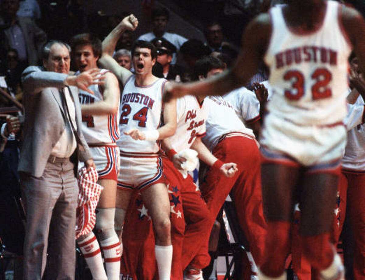Guy V. Lewis, left, coached UH to a victory over Louisville at the 1983 Final Four.