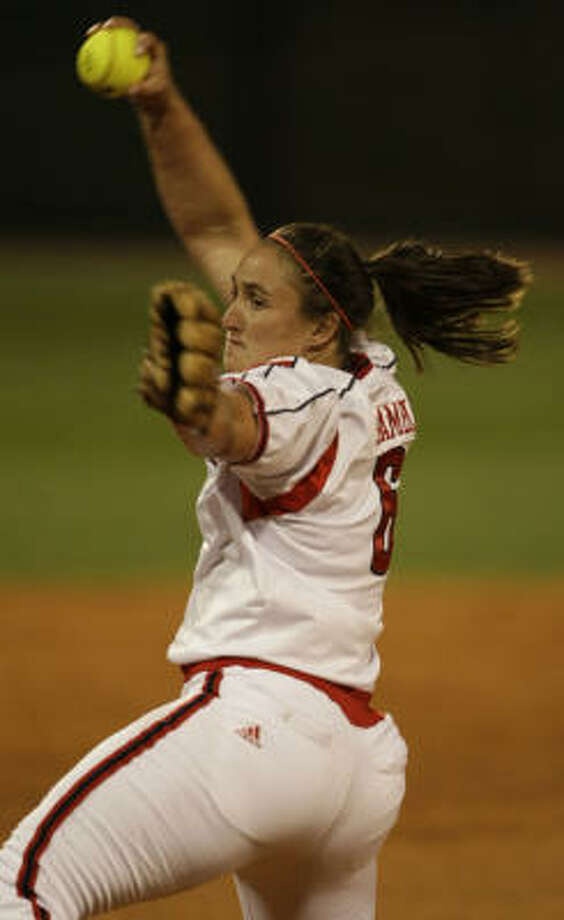 Cougars pitcher Angel Shamblin delivers a pitch in the 5th inning of what would become her perfect game against Delaware State. Photo: Karen Warren, Chronicle