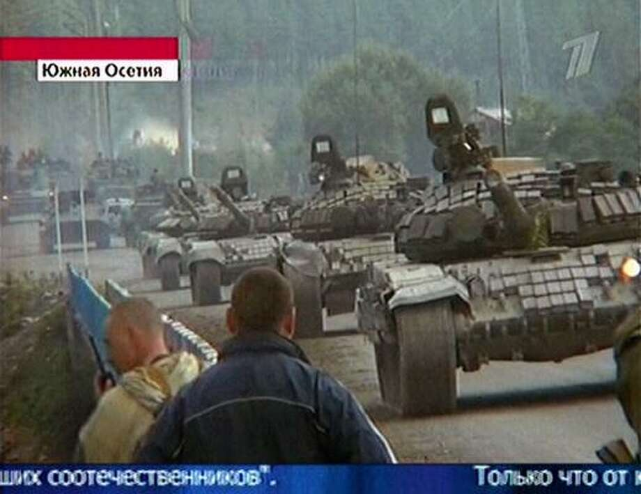 In this image made from television, what Russian Channel 1 claims  is a convoy of Russian tanks moves towards Tskhinvali  in the South Ossetian Georgian enclave today. Photo: TV, AP