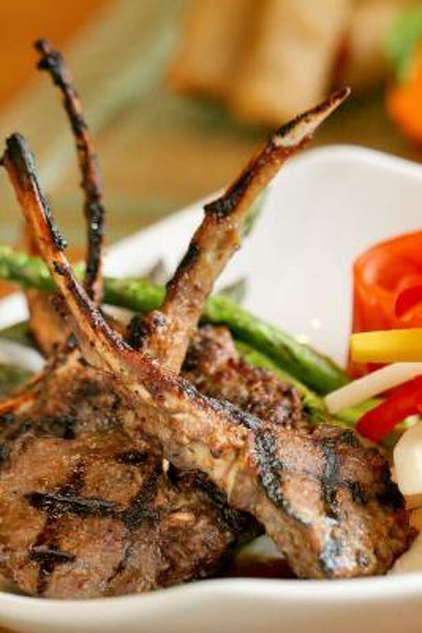 Rack of lamb is one of the more beautiful entree dishes on the Hue menu. Photo: BILL OLIVE, FOR THE CHRONICLE