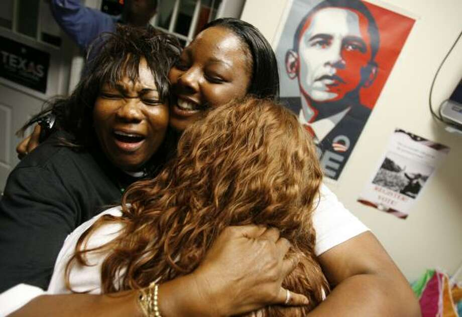 Elaine Oliver, left, and Tarsha Hardy, center, both of Houston, celebrate with another campaign volunteer at the Houston Obama for America headquarters after learning that Barack Obama won the presidency Tuesday. Photo: SHARÓN STEINMANN, CHRONICLE