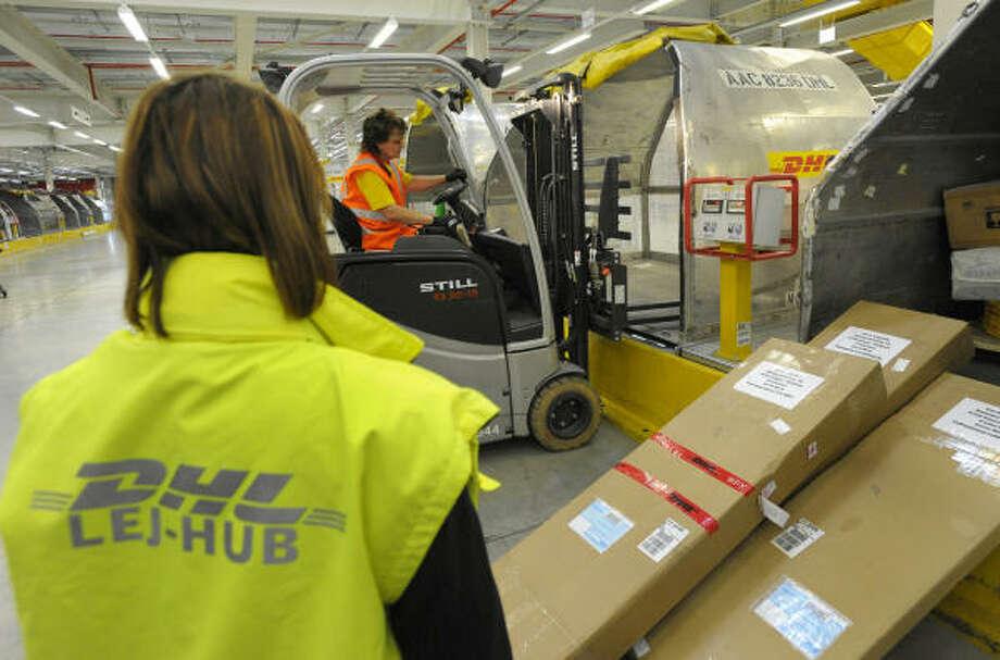 DHL to eliminate 9,500 jobs at U S  unit - Houston Chronicle