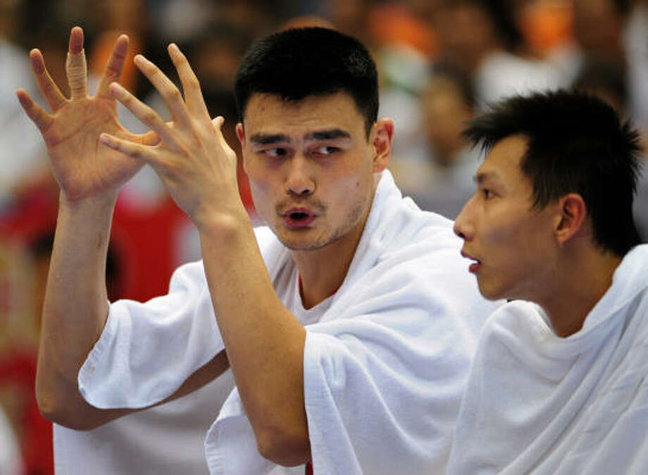 Chinese National Team teammates Yao Ming, left, and Yi Jianlian shown during the 2008 Olympic Games in China. Photo: FREDERIC J. BROWN, AFP/Getty Images