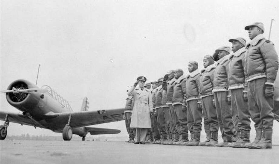 Maj. James A. Ellison, left, returns a salute as he inspects Army Air Corps cadets at the Tuskegee Institute in Tuskegee, Ala., in 1942. President Truman desegregated the military in 1948. Photo: Anonymous, U.S. ARMY SIGNAL CORPS FILE