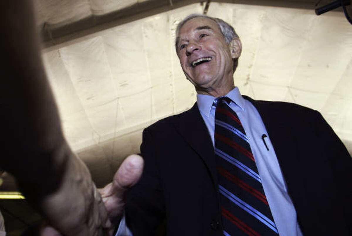 Ron Paul greets supporters Sunday at a GOP Presidential Brunch in Milford, N.H. He now is banking that his campaign cash cushion will give him the boost to compete at least through Super Tuesday, Feb. 5.