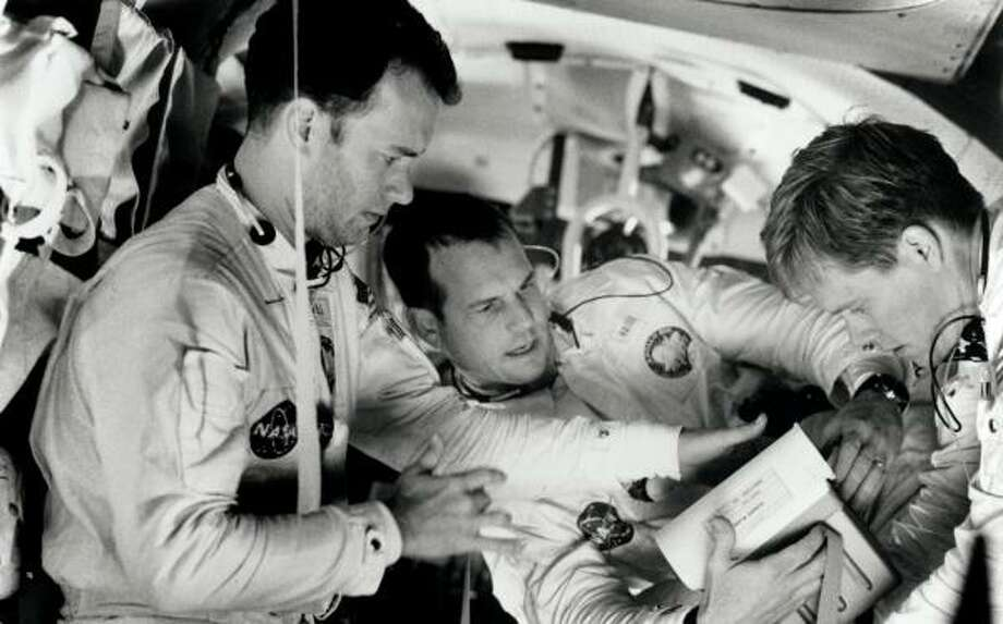 The dramatic story of Apollo 13 — and that famous phrase — was brought to life in a film of the same name starring, from left, Tom Hanks, Bill Paxton and Kevin Bacon. Photo: RON BATZDORFF, UNIVERSAL PICTURES