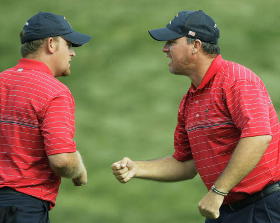 Boo Weekley, right, is congratulated by U.S. teammate J.B. Holmes after winning his match on the 16th hole. Photo: David J. Phillip, AP