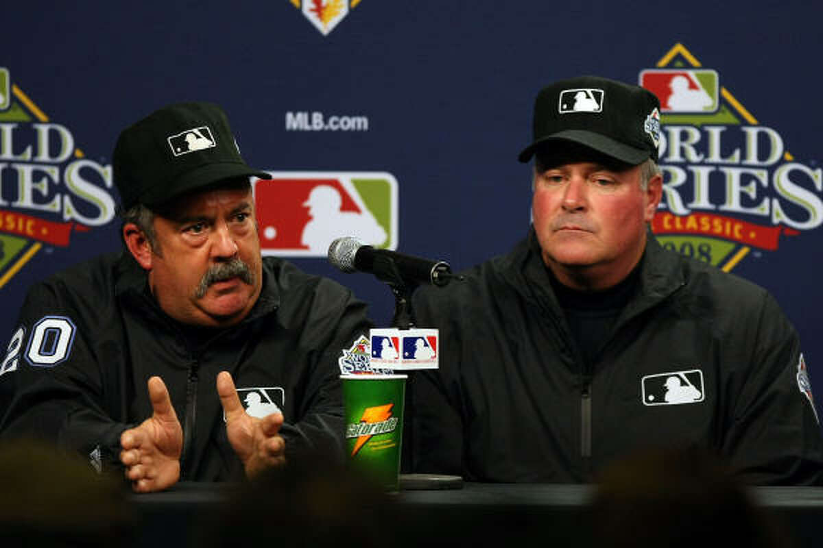 Major League Baseball umpires (L-R) Tim Tschida and Tim Welke explain their reasoning for suspending Game 5 of the World Series.