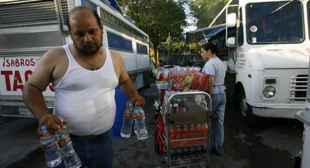 Josue Ortiz stocks one of his trucks on Houston's east side Tuesday before driving to construction sites to sell food.