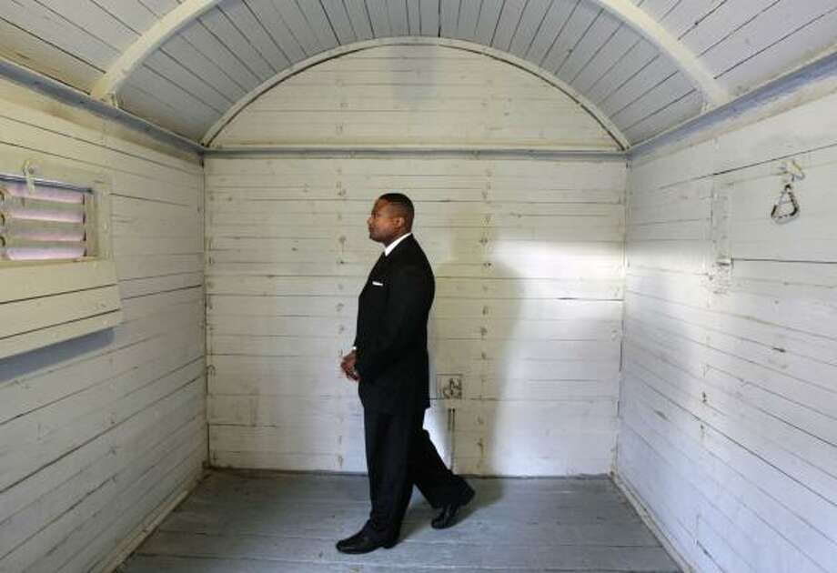 Quanell X, in a World War II-era railcar Monday, was welcomed by leaders of the Holocaust Museum Houston to take a tour. Photo: BILLY SMITH II, CHRONICLE