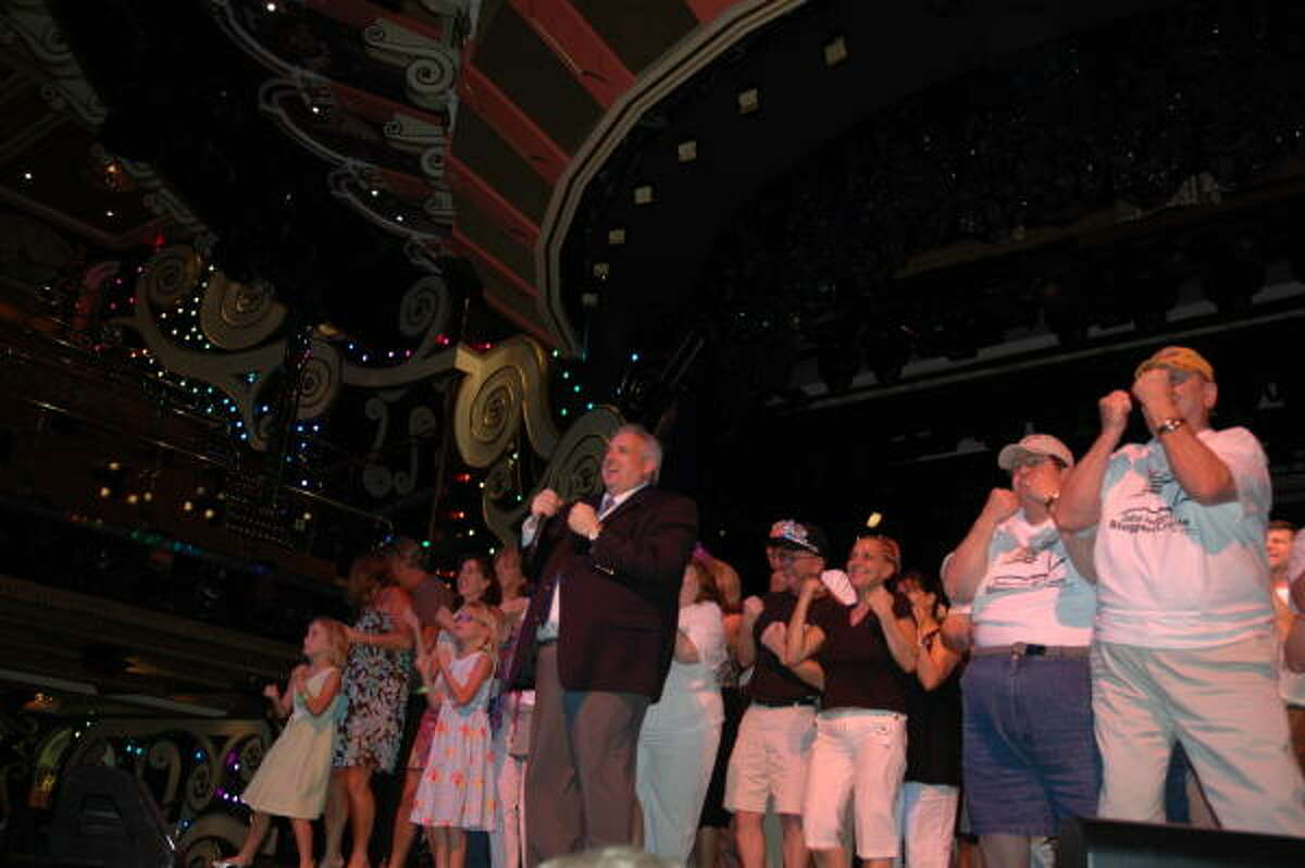 John Heald, in foreground at left, and Ed Konefe - aka Big Ed, second from right - lead the fun aboard the Carnival Freedom.